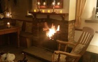 Relax by the open fire with a glass of wine.