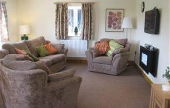 The lounge in The Stable, our 5 star, fully accessible cottage